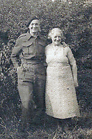 BNPS.co.uk (01202 558833)<br /> Pic: HannBooks/BNPS<br /> <br /> PICTURED:  Paratrooper Stanley Hann pictured with his mum Clara in 1944.<br /> <br /> Remarkable photos taken deep behind enemy lines by an SAS unit during a daring wartime operation have come to light on the 75th anniversary of the mission. <br />  <br /> The little-known Operation Galia on the 27th December 1944 involved just 33 SAS men hoodwinking the Nazis and their fascist allies into thinking a much greater force had landed behind them in Italy in December 1944.<br />  <br /> Adolf Hitler's forces had just launched a major surprise offensive in the Ardennes Forest in Belgium that became known as the Battle of the Bulge.<br /> <br /> Robert Hann, whose late father was SAS Paratrooper Stanley Hann, retraced his father's wartime experiences and part of his [father's] epic 80 mile long escape route through the Apennine mountains which the men took, to help him write the book 'SAS Operation Galia.'