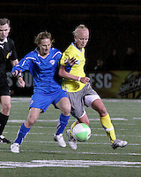 Boston Breakers midfielder Kristine Lilly (13) tackles Philadelphia Independence forward Amy Rodriguez (8) for possession of the ball.  The Boston Breakers tied the Philadelphia Independence, 1-1, at Harvard Stadium on April 18.2010