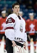 Raimonds Ermics (Latvia - 30) - Team Switzerland defeated Team Latvia 7-5 on Wednesday, December 30, 2009, at the Credit Union Centre in Saskatoon, Saskatchewan, during the 2010 World Juniors tournament.