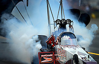 Oct. 6, 2012; Mohnton, PA, USA: NHRA top fuel dragster driver Rit Pustari damaging some pistons during qualifying for the Auto Plus Nationals at Maple Grove Raceway. Mandatory Credit: Mark J. Rebilas-
