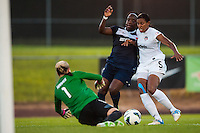 Washington Spirit goalkeeper Ashlyn Harris (1) denies Sky Blue FC forward Danesha Adams (9) as defender Candace Chapman (5) applies pressure. Sky Blue FC defeated the Washington Spirit 1-0 during a National Women's Soccer League (NWSL) match at Yurcak Field in Piscataway, NJ, on July 6, 2013.
