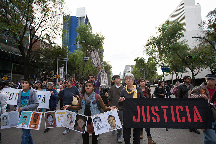 Thousands march to mark the three months since the disappearance of 43 Ayotzinapa's teaching college students in Mexico City on December 26, 2014. The 43 students went missing on Sept. 26 after confrontations in which police gunfire killed six people and wounded at least 25 in Iguala, in Guerrero state. Alexander Mora Venancio, one of the 43 missing students of Ayotzinapa, has been identified and confirmed dead by authorities.  Many are demanding justice and that the search for the 42 missing students continue until there is concrete evidence to the contrary. Mexico – officially - lists more than 20 thousand people as having gone missing since the start of the country's drug war in 2006, and the search for the missing students has turned up other, unrelated mass graves. (Photo by Benedicte Desrus)
