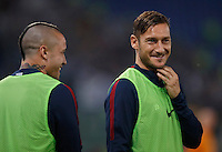 Calcio, Serie A: Roma vs Inter. Roma, stadio Olimpico, 2 ottobre 2016.<br /> Roma&rsquo;s Radja Nainggolan, left, and Francesco Totti smile as they warm up during the Italian Serie A football match between Roma and FC Inter at Rome's Olympic stadium, 2 October 2016.<br /> UPDATE IMAGES PRESS/Isabella Bonotto