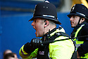 A policeman draws his truncheon and shouts at fans during the Blue Square Premier play-off semi-final 2nd leg  match between Luton Town and York City at Kenilworth Road, Luton on Monday 3rd May, 2010..© Kevin Coleman 2010 ..
