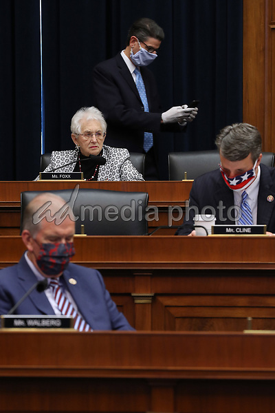 United States House Education and Labor Committee ranking member United States Representative Virginia Foxx (Republican of North Carolina) does not wear a face mask while her fellow committee members and staff wear them during a hearing about the federal government's role in protecting workers during the pandemic on Capitol Hill May 28, 2020 in Washington, DC. More than 62,000 health care workers have been infected with COVID-19 and close to 300 have died according to the U.S. Centers for Disease Control. <br /> Credit: Chip Somodevilla / Pool via CNP/AdMedia