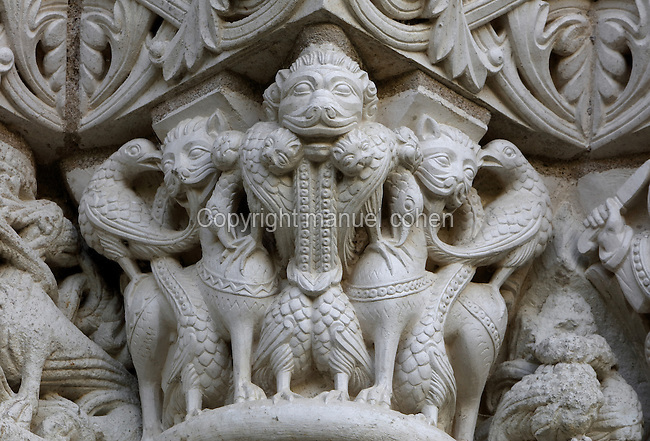 Carved capitals with fantastic beasts entwined with foliage, on the facade of the Abbey Church, Romanesque, built 1105-60, at Fontevraud Abbey, Fontevraud-l'Abbaye, Loire Valley, Maine-et-Loire, France. The abbey was founded in 1100 by Robert of Arbrissel, who created the Order of Fontevraud. It was a double monastery for monks and nuns, run by an abbess. The order was dissolved during the French Revolution and the building subsequently used as a prison. The abbey is listed as a historic monument and a UNESCO World Heritage Site. Picture by Manuel Cohen