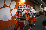 Clemson's Tyshon Dye (22) Tavien Feaster (28) and Adrian Baker (21) take the field before the 2017 College Football Playoff National Championship against Alabama in Tampa, Florida on January 9, 2017.  Photo by Mark Wallheiser/UPI