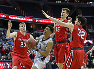 Washington, DC - March 10, 2018: St. Bonaventure Bonnies guard Jaylen Adams (3) is defended by serveral Davidson Wildcats players during the Atlantic 10 semi final game between St. Bonaventure and Davidson at  Capital One Arena in Washington, DC.   (Photo by Elliott Brown/Media Images International)