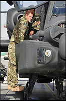 BNPS.co.uk (01202 558833)<br /> Pic: CrownCopyright/AirHistoricalBranch<br /> <br /> Prince Harry with his British Army Apache in 2012.<br /> <br /> A new book gives an intimate look behind the scenes of the Royal Flight and also the flying Royals.<br /> <br /> Starting in 1917 the book charts in pictures the 100 year evolution of first the King's Flight and then later the Queen's Flight as well as the Royal families passion for aviation.<br /> <br /> Author Keith Wilson has had unprecedented access to the Queen's Flight Archives to provide a fascinating insight into both Royal and aeronautical history.