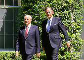 United States President George H.W. Bush, right, walks President Mikhail Gorbachev of the Union of Soviet Socialist Republics, left, to his car following a state arrival ceremony on the South Lawn of the White House in Washington, DC on Thursday, May 31, 1990.  It was the start of three days of talks between the two leaders.<br /> Credit: Ron Sachs / CNP
