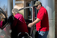 NWA Democrat-Gazette/JASON IVESTER --01/26/2015--<br /> Richard Embry with Hope Cancer Resources helps patient Rowena Smith into his vehicle on Monday Jan. 26, 2015, at the Highlands Oncology Center in Rogers. Embry was transporting Smith to her Holiday Island home following treatment at the center.