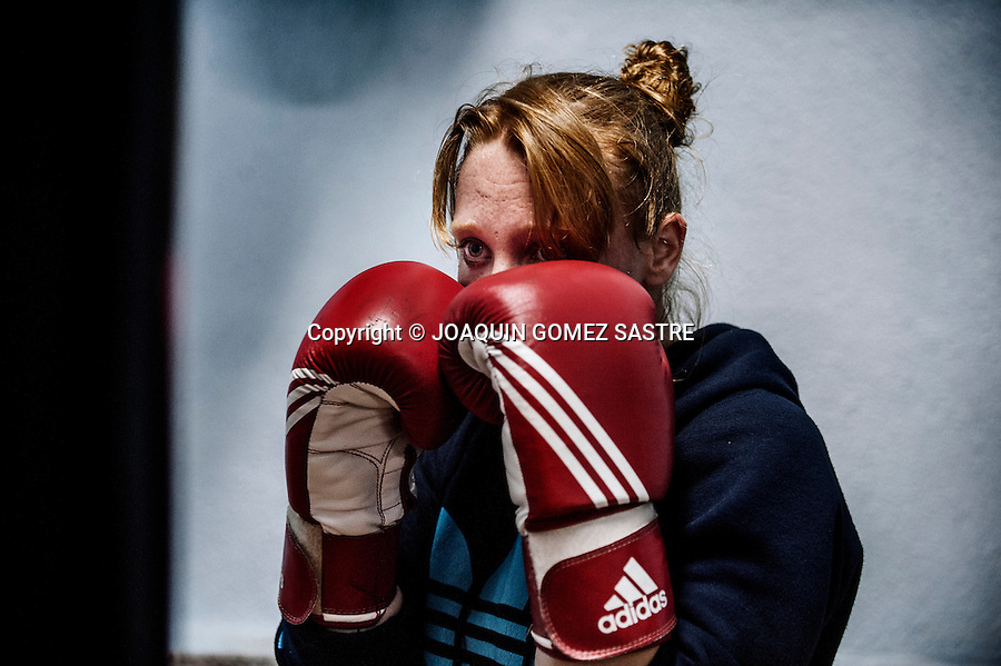 The boxer Maria focused during training at the Martinez Boxing Club