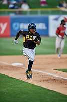 Eric Young Jr. (8) of the Salt Lake Bees heads to home plate during the game against the Sacramento River Cats at Smith's Ballpark on May 17, 2018 in Salt Lake City, Utah. Salt Lake defeated Sacramento 12-11. (Stephen Smith/Four Seam Images)