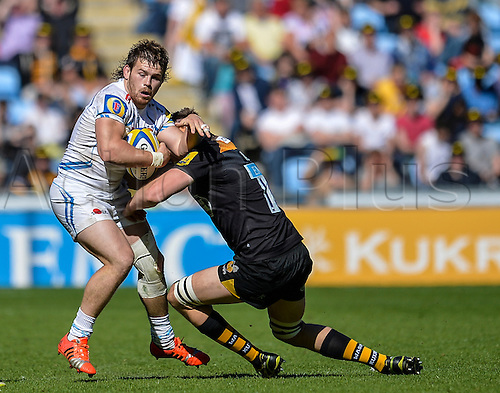 26.04.2015.  Coventry, England.  Aviva Premiership. Wasps versus Exeter Chiefs. Luke Cowan-Dickie (Exeter) is tackled by James Cannon (Wasps).