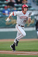 Casey Smith #20 of the Indiana Hoosiers runs to first base during a game against the Long Beach State Dirtbags at Blair Field on March 14, 2014 in Long Beach, California. Long Beach State defeated Indiana 4-3. (Larry Goren/Four Seam Images)