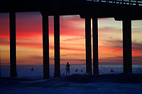 March 10, 2016 - San Diego, California, USA- A stand up paddle boarder paddles near the Scripps Pier as the sun sets at La Jolla Shores beach in San Diego, California.  (Photo Credit: © K.C. ALFRED/ZUMA PRESS)