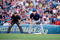 Mobile BayBears first baseman Matt Thaiss (21) in front of first base umpire Jonathan Parra during a game against the Jacksonville Jumbo Shrimp on April 14, 2018 at Baseball Grounds of Jacksonville in Jacksonville, Florida.  Mobile defeated Jacksonville 13-3.  (Mike Janes/Four Seam Images)