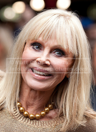24/09/2012. LONDON, UK. Actress Britt Ekland, who played Bond Girl 'Goodnight' in 'The Man with the Golden Gun' is seen outside HMV in Oxford Street, London, today (24/09/12) during a photocall. The stars were in London during the final leg of a UK tour to promote the Bond 50 Blu-Ray collection.  Photo credit: Matt Cetti-Roberts
