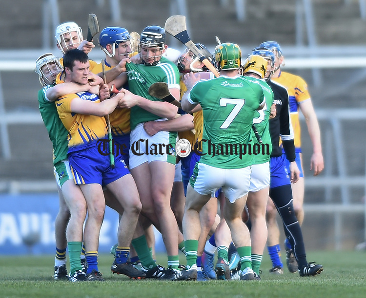 Clare and  Limerick players exchange views during their NHL quarter final at the Gaelic Grounds. Photograph by John Kelly.