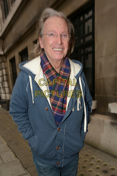 Tommy Steele.Spotted in London, England..31st October 2012 .** EXCLUSIVE ALL-ROUNDER**.half length jacket hands in pockets blue scarf plaid tartan glasses.CAP/IA.©Ian Allis/Capital Pictures.