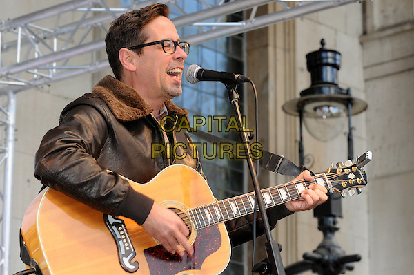 Nick Heyward of The View.BBC Children In Need's Pudsey Street -photocall, New Piazza, Covent Garden, London, England..3rd November 2012.on stage in concert live gig performance performing music half length black profile leather jacket glasses singing guitar .CAP/PP/BK.©Bob Kent/PP/Capital Pictures
