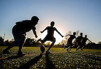 NWA Democrat-Gazette/JASON IVESTER <br /> Area youth start a game of football on one of the new turf fields on Wednesday, Nov. 11, 2015, following a grand re-opening ceremony for Veterans Park in Rogers.