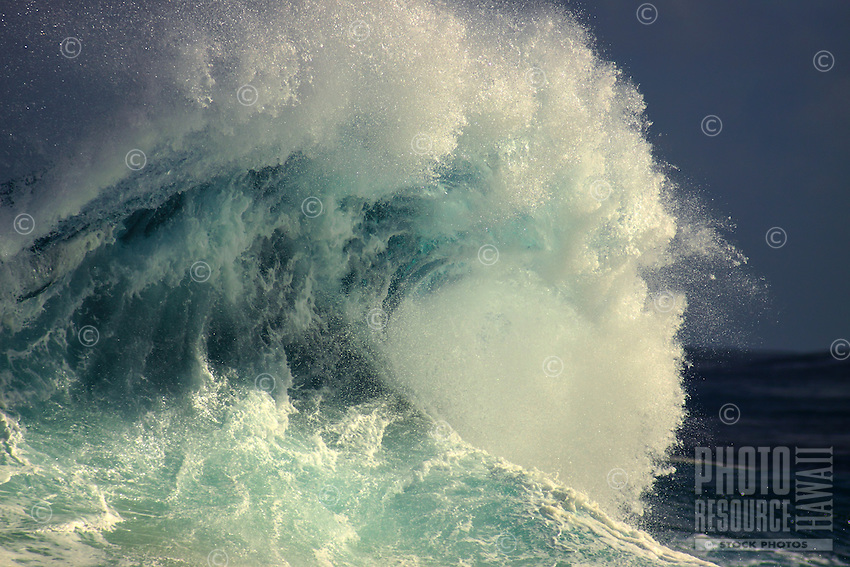 A big wave pitching towards shore, North Shore, O'ahu.