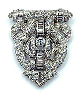 BNPS.co.uk (01202 558833)<br /> Pic: KidsonTrigg/BNPS<br /> <br /> £1500 - Art Deco clip brooch in unmarked white metal, set throughout with round & baguette cut diamonds.<br /> <br /> Frozen Assets - Over a £100,000 of Renaissance era jewellry found under a frozen joint of lamb in a run down chalet bungalow is coming up for auction.<br /> <br /> Amazed auctioneers found the hidden gems in the ramshakle hoarders freezer near Uffington in Wiltshire - where the canny late owner had gone to great lengths to protect her precious haul.<br /> <br /> However, the hidden stash wasn't the result of a bank heist but belonged to an eccentric collector who amassed the items in the 1960s - and kept the receipts to prove it.<br /> <br /> She passed away recently and her family brought in experts to hunt out relics they knew their relative had hidden away over the years.