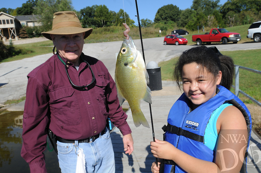NWA Democrat-Gazette/FLIP PUTTHOFF <br /> Kayleigh Peoples shows Sept. 30 2016 a fish she caught with help from Ron Blackwelder of the Fly Tyers.
