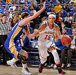 SIOUX FALLS, SD - MARCH 10: Kelly Stewart #15 from the University of South Dakota drives against Megan Waytashek #24 from South Dakota State University in the first half of the Summit League Championship Tournament game Tuesday at the Denny Sanford Premier Center in Sioux Falls, SD. (Photo by Dave Eggen/Inertia)