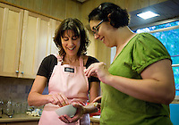 Sharon Bardfield (cq, right) and personal canning coach Kelly Ingram (cq smile as they dip bread into a freshly made peach jam, made by Bardfield, during a canning class at the home of Wall Street Journal reporter Ana Campoy in Dallas, Texas, USA, Saturday, Sept. 12, 2009. Growing produce or buying locally grown vegetables and canning at home is a fun and healthy way to keep grocery costs down...CREDIT: Matt Nager for The Wall Street Journal