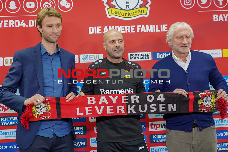 04.01.2019, BayArena, Leverkusen, GER, 1. FBL,  Bayer 04 Leverkusen PK Trainerwechsel,<br />  <br /> DFL regulations prohibit any use of photographs as image sequences and/or quasi-video<br /> <br /> im Bild / picture shows: <br /> erste Pressekonferenz von Peter Bosz Trainer / Headcoach (Bayer 04 Leverkusen), mit li SIMON ROLFES Direktor Sport (Bayer 04 Leverkusen),  re Rudi V&ouml;ller/ Voeller Geschaeftsfuehrer Sport (Bayer 04 Leverkusen), <br /> <br /> Foto &copy; nordphoto / Meuter