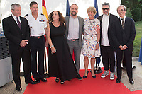 French Ambassador in Spain Yves Saint-Geours (R) and his wife Jocilene (3rd R); Spanish fashion designer Manu Fernandez (2nd R)
