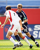 The New England Revolution's Taylor Twellman is marked by D.C. United's Brandon Prideaux. The New England Revolution and D.C. United finished in a scoreless tie in MLS play at Gillette Stadium, Foxboro, MA on Saturday August 28, 2004.