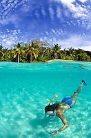 Split level view of a snorkeler in clear water<br /> Salomon Beach<br /> Virgin Islands National Park<br /> St. John, U.S. Virgin Islands