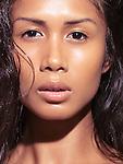 Closeup natural sensual beauty portrait of a young woman looking at camera