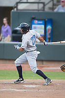 Ramon Torres (22) of the Wilmington Blue Rocks follows through on his swing against the Winston-Salem Dash at BB&T Ballpark on June 10, 2015 in Winston-Salem, North Carolina.  The Blue Rocks defeated the Dash 11-5.  (Brian Westerholt/Four Seam Images)