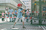 10 June 2006: Soccer fans and locals enjoy market day in Frankfurt before the game. A young girl takes her swings in a baseball batting cage. England played Paraguay at Commerzbank Arena in Frankfurt, Germany in match 3, a Group B first round game, of the 2006 FIFA World Cup.