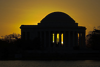 Jefferson Memorial backlit by the rising sun, Washington, DC