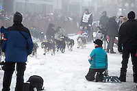 Nicholas Petit runs in the fog and amongst the spectators on 4th avenue during the ceremonial start of the Iditarod sled dog race Anchorage Saturday, March 2, 2013. ..Photo (C) Jeff Schultz/IditarodPhotos.com  Do not reproduce without permission