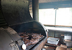 Franklin Barbecue smokes brisket at their new location on East 11th st.  in Austin, Texas...Ben Sklar for VICE Magazine