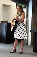 "Pictured: Eve Stewart, one of the granddaughters of Pat Stewart is singing a song in tribute to her grandmother wearing a spotty dress.<br /> Re: The funeral of Pat Stewart at the Cardiff and Glamorgan Memorial Park and Crematorium, Wales, UK. Pat Stewart became famous as ""the girl in the spotty dress"" after an iconic image taken by Bert Hardy in Blackpool in 1951."