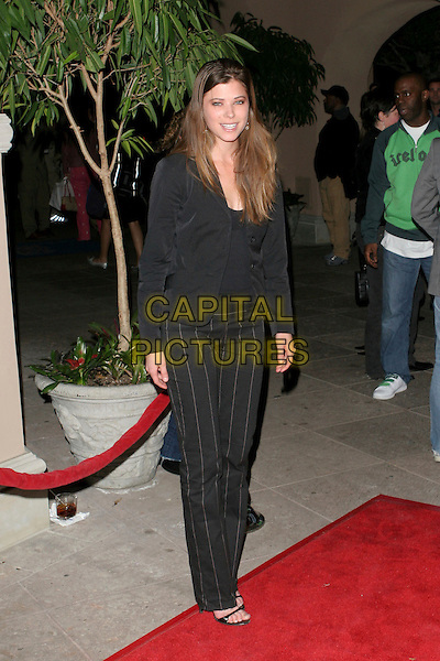 PEYTON LIST.NBC 2006 TCA Winter Press Tour Party - Arrivals held at the Ritz Carlton,Pasadena, California..January 22nd, 2006.Photo: Zach Lipp/AdMedia/Capital Pictures.Ref: ZL/ADM.full length black trousers pinstripe jacket.www.capitalpictures.com.sales@capitalpictures.com.© Capital Pictures.