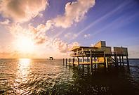 wood stilt house on sand banks of Safety Valve, at sunrise, Stiltsville, Miami, Biscayne National Park, Florida, USA, Atlantic Ocean