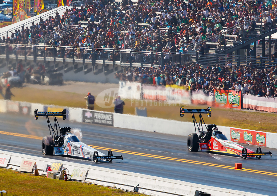 Mar 17, 2018; Gainesville, FL, USA; NHRA top fuel driver Antron Brown (left) races alongside Doug Kalitta during qualifying for the Gatornationals at Gainesville Raceway. Mandatory Credit: Mark J. Rebilas-USA TODAY Sports
