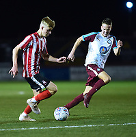 Lincoln City U18's Josh Woodcock vies for possession with South Shieldsy U18's Will McCamley<br /> <br /> Photographer Andrew Vaughan/CameraSport<br /> <br /> The FA Youth Cup Second Round - Lincoln City U18 v South Shields U18 - Tuesday 13th November 2018 - Sincil Bank - Lincoln<br />  <br /> World Copyright © 2018 CameraSport. All rights reserved. 43 Linden Ave. Countesthorpe. Leicester. England. LE8 5PG - Tel: +44 (0) 116 277 4147 - admin@camerasport.com - www.camerasport.com