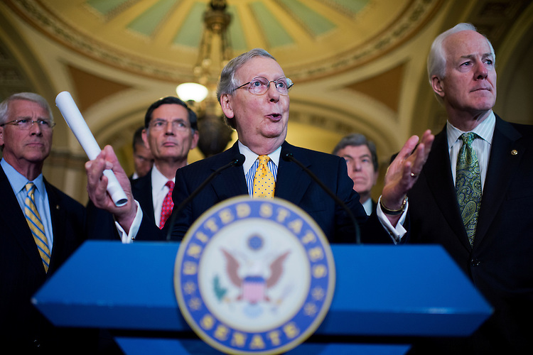UNITED STATES - JULY 21: Senate Majority Leader Mitch McConnell, R-Ky., conducts a news conference after the Senate Policy luncheons in the Capitol, July 21, 2015. Appearing behind him, from left, are Sens. Roger Wicker, R-Miss., John Thune, R-S.D., John Barrasso, R-Wyo., Roy Blunt, R-Mo., and Majority Whip John Cornyn, R-Texas.(Photo By Tom Williams/CQ Roll Call)