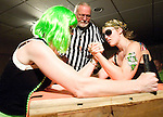 """The Gazette Members of the DC Lady Arm Wrestlers league or DCLAW Christine Jasper of Silver Spring otherwise known as """"Green Fear"""" (left) goes up against Silver Spring resident Jenny Schenck or """"Army of One"""" (right) as Washington, D.C. resident Philip Yunger (center) referees the bout during the leagues inaugural competition held at the American Legion Post 8 in Washington, D.C. on Saturday evening. All proceeds of the competition went to the non-profit House of Ruth."""