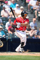 Ricky Oropesa (33) of the Richmond Flying Squirrels follows through on his swing against the Bowie Baysox at The Diamond on May 24, 2015 in Richmond, Virginia.  The Flying Squirrels defeated the Baysox 5-2.  (Brian Westerholt/Four Seam Images)