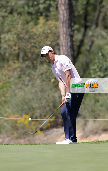 Matteo Manassero (ITA) chips onto the 7th green during Thursday's Round 1 of the 2014 Open de Espana held at the PGA Catalunya Resort, Girona, Spain. Wednesday 15th May 2014.<br /> Picture: Eoin Clarke www.golffile.ie